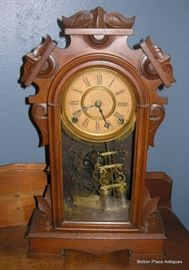 Antique Ansonia  Walnut Clock in working Condition, and has a beautiful tone
