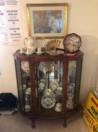 Walnut Curio with key and collectible tea cups