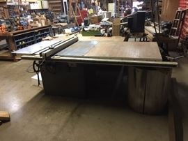 Same Machine-different view. Note the owner of the shop made the table larger and added a longer guide!