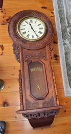 Gorgeous ornately carved regulator wall clock.
