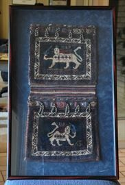 Saddlebags of finely woven wool (like a Persian carpet) - one side was reversed for framing.  Iconography is like what was sometimes associated with the reign of King Cyrus.  Client identified them as bicycle saddlebags.
