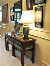View of a very fine table lamp and console table with protective glass top.    Stools are separate items.  Many finely framed Persian items.