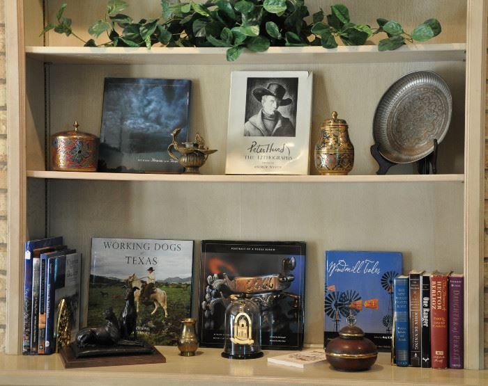 Bookshelves with Texas and Lubbock area books, one of 4 Texas Tech ornaments, 1950s Nepal bronze ceremonial lamp (copy of lmap used in the 1700s)