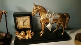 United Clock Works - large western horse with boots and hat.  good condition but clock not working.  located in dining room