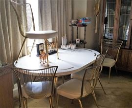 fabulous retro dining set - white formica table with gold details comes with 2 leaves and 6 chairs - one chair has condition issues, see coming photo
