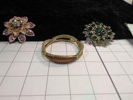 Monet gold bracelet and two broaches   https://ctbids.com/#!/description/share/86453