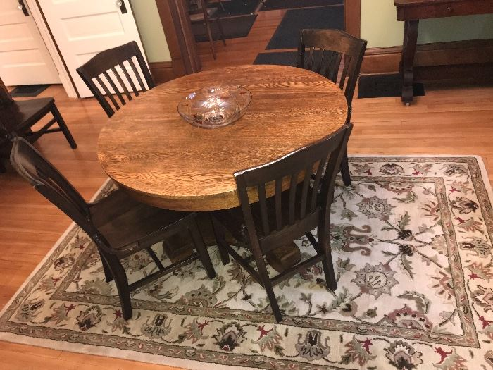 Nice oak table, set of chairs, and wool rug from India