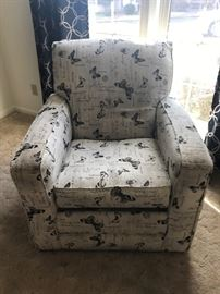 Large upholstered swivel chair