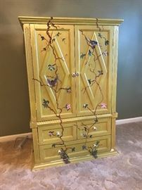 Large tv/ storage cabinet with drawers and hand painted motif