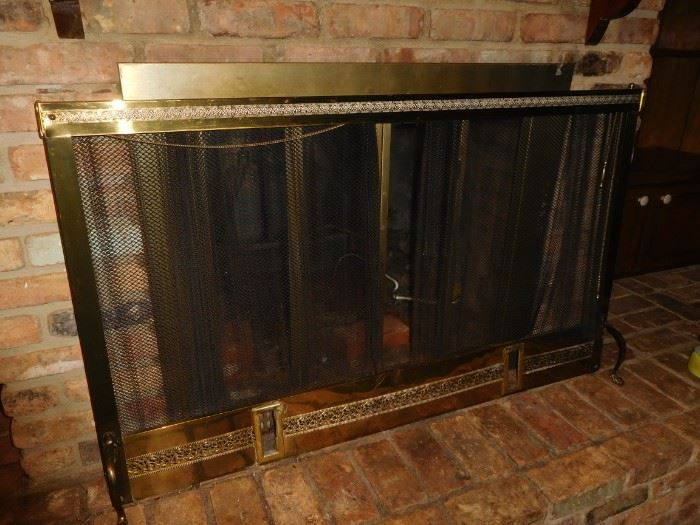 Free standing brass fire screen