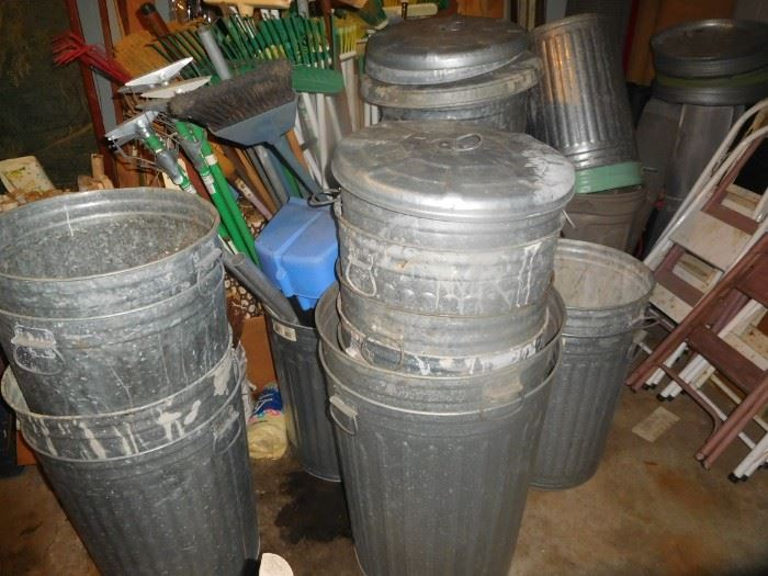 At least 15 galvanized cans with lids