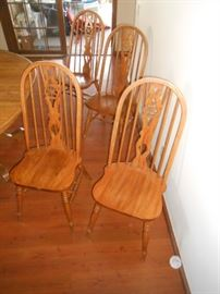 4 arched oak chairs