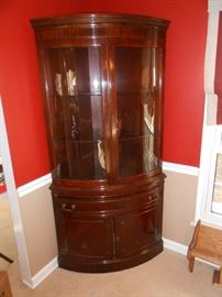 This is a beautiful corner cabinet 2/glass doors, 1/drawer and 2 bottom doors