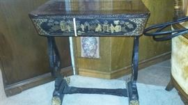 This is a circa 1850 to 1880 Chinese export black lacquer and gilt painted sewing cabinet with ivory accessories.