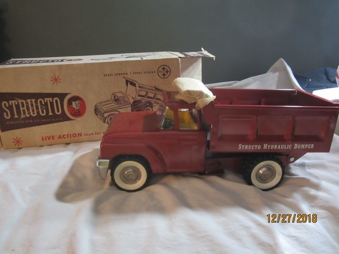 Structo Dump Truck, with original box and tissue paper.  Never played with