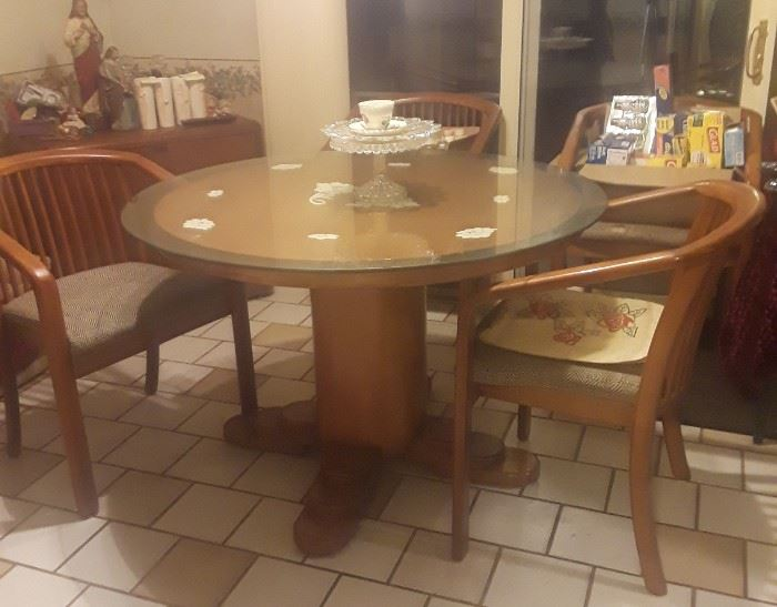 Pedestal table with glass top. Maple, cushions need recovering but the seat structure is solid.