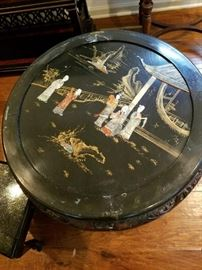 One of these wonderful Asian Inlaid Black Lacquer Tables with four stools. Yummy!