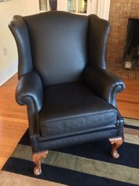 Vintage wingback chair, professionally recovered in black leather