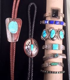 Navajo bolos by Tsosie & Mary Taylor (signed TM Taylor), Navajo sterling bracelets: with black stone by Roger Skeet, Jennifer Curtis signed bracelet with lapis, bracelet with 3 turquoise stones, unmarked stamped bracelet with square turquoise stone, feather design bracelet with intarsia stone, stamped bracelet with oval turquoise by Norman Bia, unmarked narrow bracelet with small turquoise stones