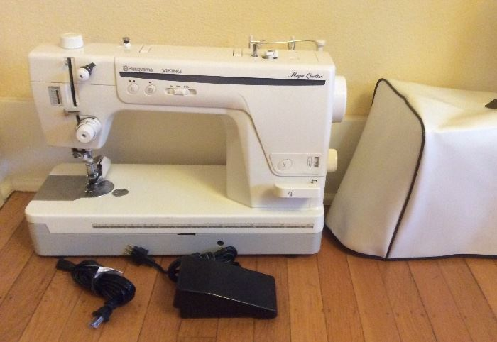 Husqvarna Viking Mega Quilter sewing machine. Includes vinyl cover, instruction DVD, leg control arm & low plastic table that fits around machine (not shown) Note: This machine is for use with quilting frame - see next photo