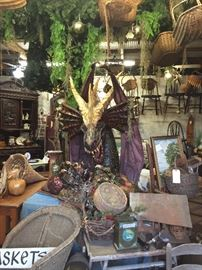 The dragons lair! Great baskets, bamboo table, vintage wicker chair
