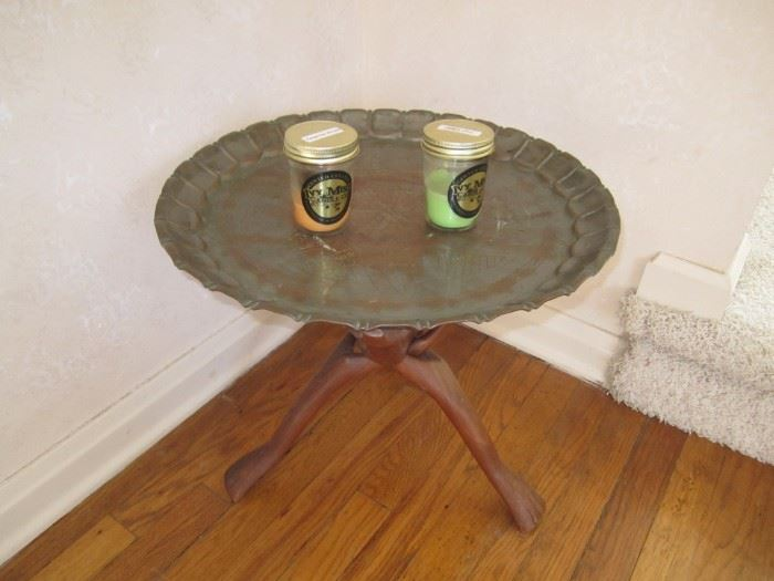 Brass table on tree legs