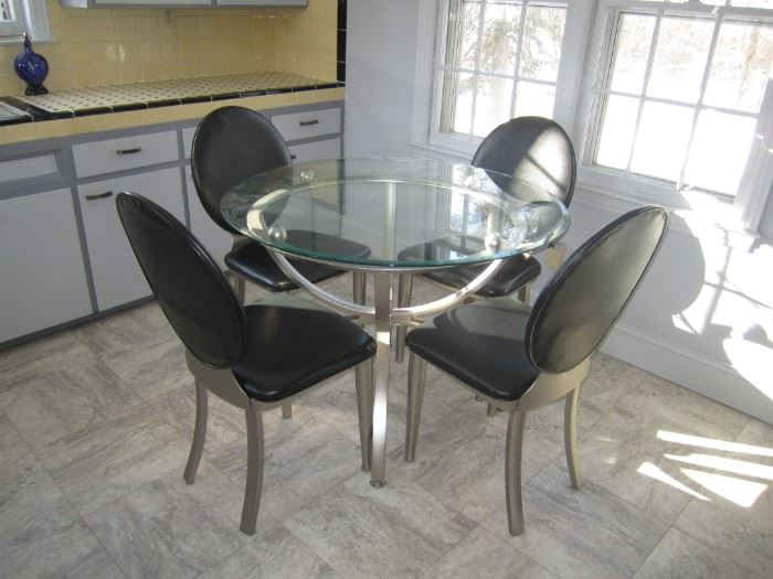 Modern Chrome dining table and black and chrome chairs
