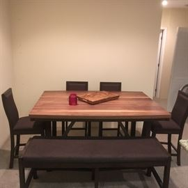 1 year old kitchen table.  4 seats and one bench.