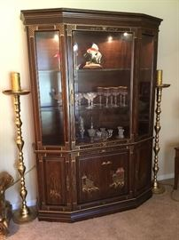 Chinoiserie brown bookcase. Pair of tall 5' brass candlesticks