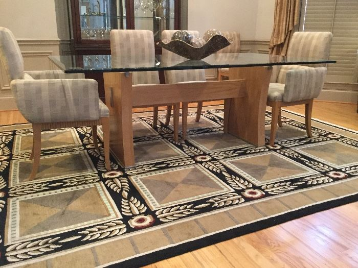 """Contemporary glass top dining table with 8 chairs. Yours for just $1250! 79"""" L x 44"""" W. RUG IS NOT FOR SALE!"""