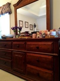 In The Master Is A Really Nice Bedroom Set!...Including This 9 Drawer Dresser w/Mirror...