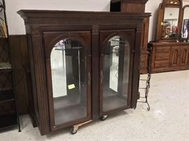 This is the top 1/2 of a beautiful china cabinet - the bottom portion is behind the glass part.