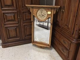 Wall Clock with decorative mirror and shelf.