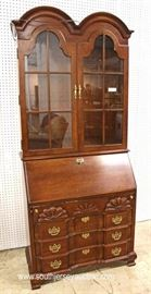 "Mahogany Block Front Slant Front Desk with Bookcase Top by ""Jasper Cabinet""  Located Inside – Auction Estimate $300-$600"