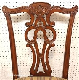"7 Piece Mahogany Banded and Inlaid Dining Room Table with 2 Leaves and 6 Carved Ball and Claw Dining Room Chairs in the Chippendale Style by  ""Ethan Allen Furniture""  Located Inside – Auction Estimate $800-$1500"