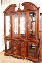 "Contemporary Mahogany Shell Carved 2 Piece Broken Arch China Cabinet with Curio Base by ""Kathy Ireland Home""  Located Inside – Auction Estimate $100-$300"