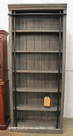 "Contemporary Gray Distressed Library Style Open Face Bookcase with original tags by ""Martin Furniture""  Located Inside – Auction Estimate $300-$600"