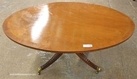 "Oval Mahogany Banded Coffee Table by ""Kindell Furniture""  Located Inside – Auction Estimate $100-$200"