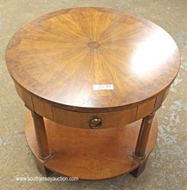"Burl Walnut Sunburst Top One Drawer Lamp Table by ""Baker Furniture""  Located Inside – Auction Estimate $100-$200"