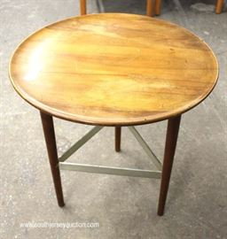 "Mid Century Modern Danish Walnut Round Lamp Table by ""Fine Furniture Exclusively Yours Big Rapids Furniture Company, New York""  Located Inside – Auction Estimate $100-$300"