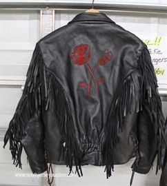 Leather Nautica Men's Jacket  Located Inside – Auction Estimate $20-$100  Leather Fringed Ladies Jacket with Embroider Roses  Located Inside – Auction Estimate $20-$100