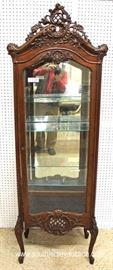 Early 20th Century Highly Carved Mirrored Back French Style Display Cabinet – Nice Size  Located Inside – Auction Estimate $300-$600