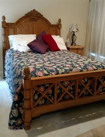 Queen master bed, Tommy Bahama. Linens sold separately. Nightstands are from Restoration Hardware
