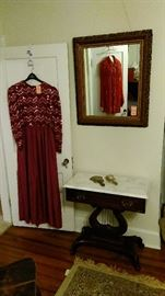 Marble top table, highly carved wall mirror and vintage evening gown