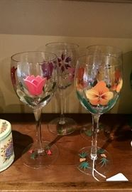 Four hand painted wine glasses