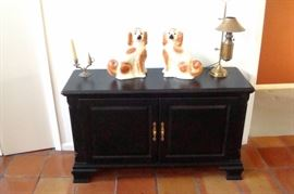 Kincaid ebony server, two antique Staffordshire dogs. early brass Kosmos Brenner converted student lamp.