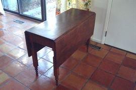 Antique cherry drop leaf table, C-1850.