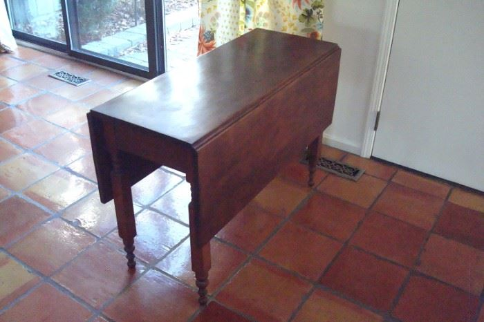 Antique cherry drop leaf table, C-1850.