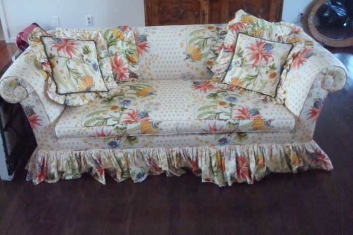 Custom upholstered love seat.