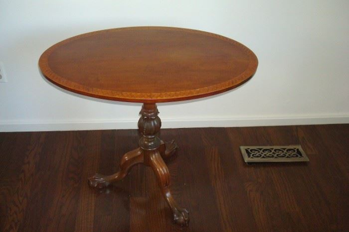 Vintage inlaid tilt top table with claw feet.